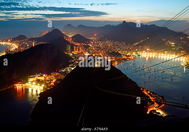 Brazil Rio de Janeiro Pao de Acucar viewpoint panoramic view toward Copacabana and Guanabara bay at night - Stock Image