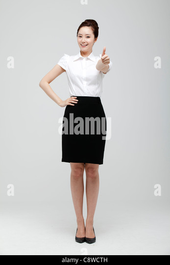 Asian Businesswoman Showing Thumb Up Sign - Stock Image