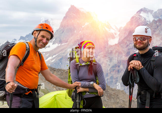 Cheerful mountain climbers portrait - Stock Image