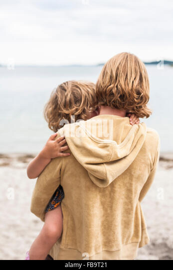 Sweden, Sodermanland, Stockholm Archipelago, Musko, Mother holding daughter (4-5) - Stock Image