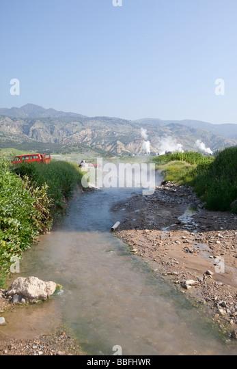 Hot springs feeding a stream of water in western Turkey - Stock Image
