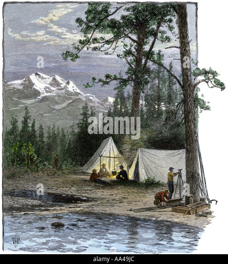 Surveyors for the railroad and their expedition in camp in the Rocky Mountains 1800s - Stock Image