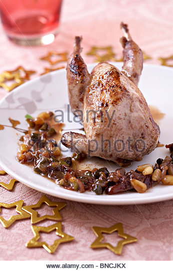 Dried fruits roasted quail - Stock Image