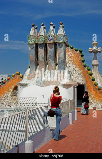 Barcelona Casa Batllo by Antoni Gaudi chimneys on roof top terasse tourists - Stock Image