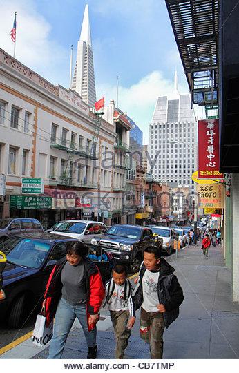 San Francisco California Chinatown ethnic neighborhood Clay Street sidewalk Asian woman mother boy teen family sibling - Stock Image