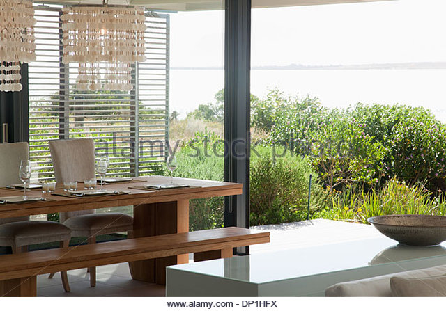 Dining table in modern home - Stock Image