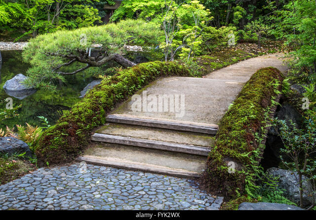 Arched japanese bridge stock photos arched japanese for Formal japanese garden
