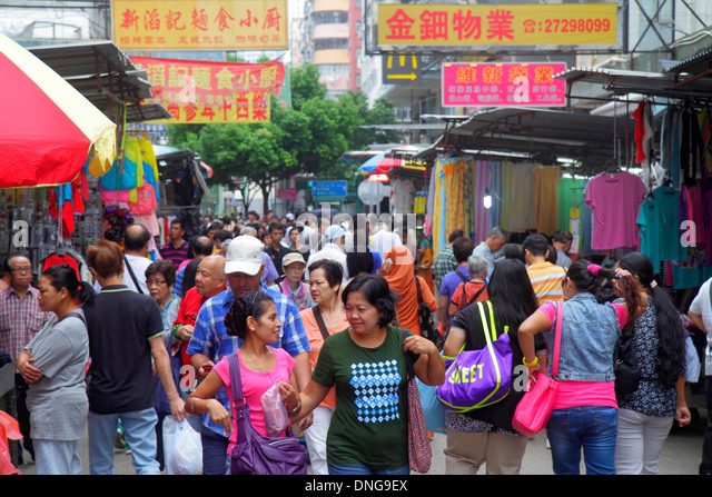 Hong Kong China Kowloon Sham Shui Po Ki Lung Street fabric market marketplace vendors stalls shopping buying selling - Stock Image