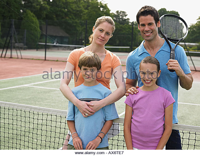 Family on a tennis court - Stock Image