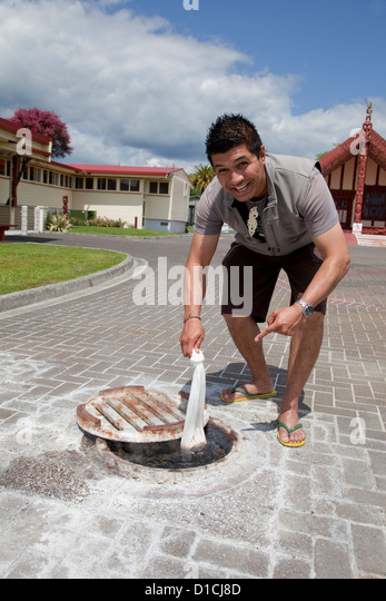 Ohinemutu Village, Rotorua, New Zealand.  Cooking Corn in Thermally Heated Water underneath plaza paving stones. - Stock Image