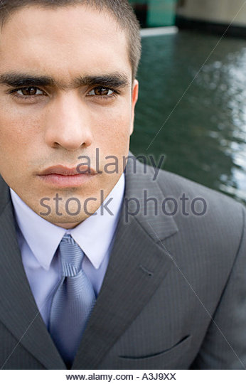 Moody young businessman - Stock Image