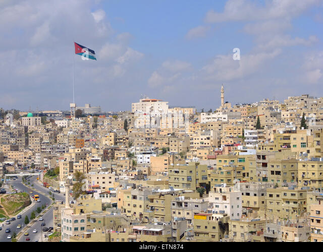 Amman flag and  skyline, Jordan - Stock Image