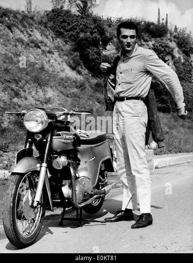 Jan 01, 1950 - File Photo: circa 1950s, location unknown. JEAN CLAUDIO next to a 1950 Triumph Thunderbird motorcycle - Stock Image