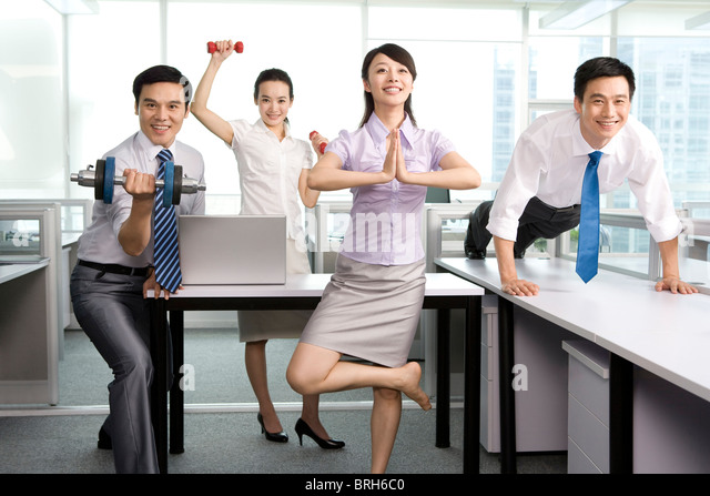 Keeping fit in the office - Stock Image