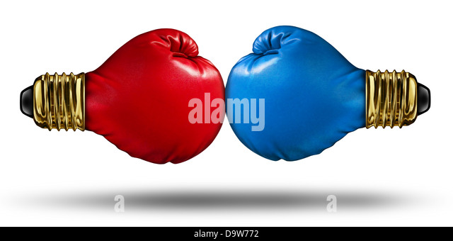 War of Ideas and debating innovative concepts with a group of two red and blue boxing gloves shaped as light bulbs - Stock Image