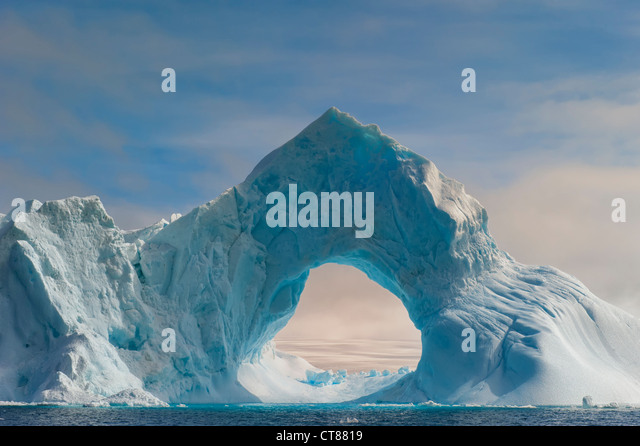 Natural Arch carved in an iceberg, Antarctic Sound, Antarctic Peninsula - Stock Image