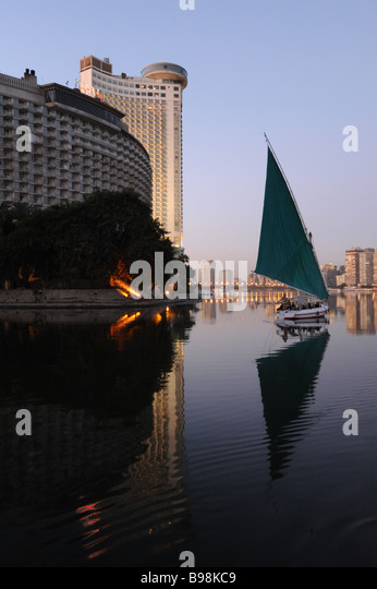 Egypt Cairo felucca sailboat on the Nile River at dawn - Stock Image