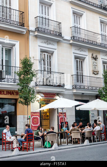 Spain Europe Spanish Madrid Salamanca Recoleto Taberna Embroque restaurant alfresco tables umbrella - Stock Image