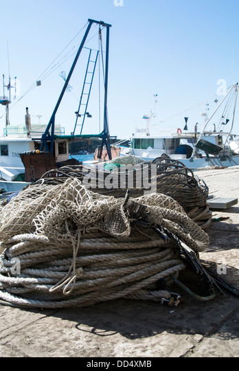 Bottom trawler with otterboards and nets at the Harbourside Porec in the Adriatic. - Stock-Bilder