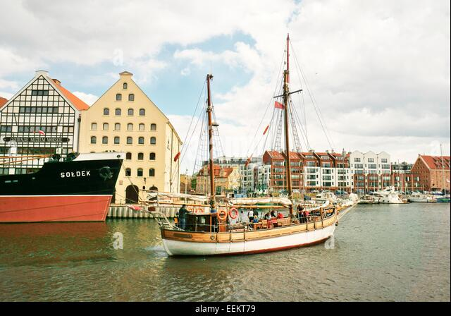 "Gdansk Poland. Sailing boat ""Gdansk"" approaches the city centre Marina on the Motlawa River - Stock Image"