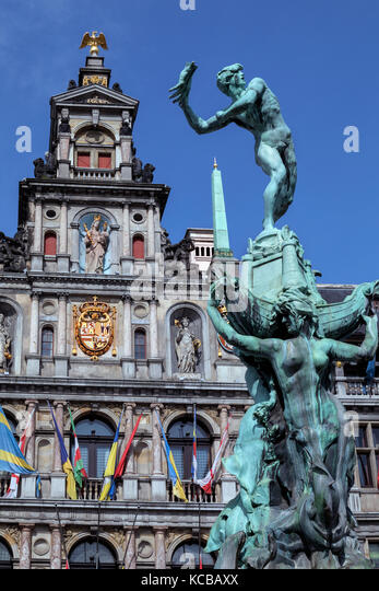 Antwerp - Belgium. Statue of Silvius Brabo throwing the giants hand in front of the Stadhuis (City Hall) of Antwerp - Stock Image