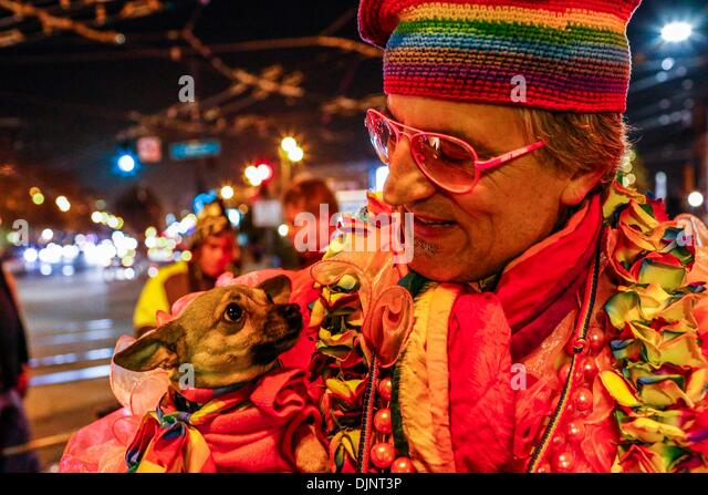 San Francisco, California, USA. 27th Nov, 2013. BRUCE BEAUDETTE and his dog 'YOKO O-YES 3' walk in a candlelight - Stock Image