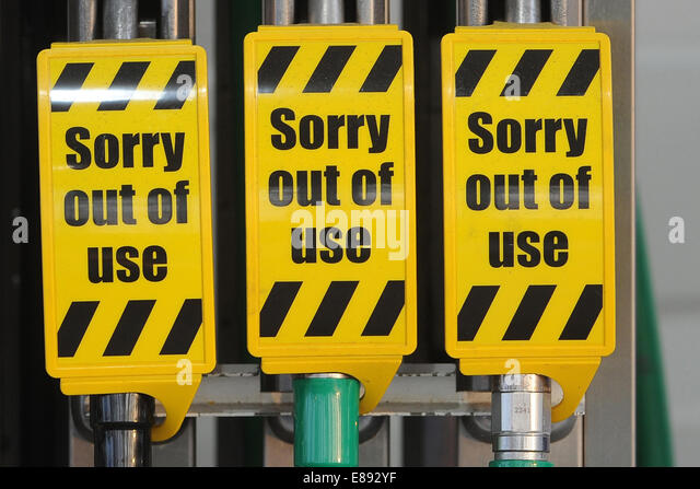 Fuel pumps with a sign that reads 'sorry out of use' after petrol/diesel shortages. - Stock Image