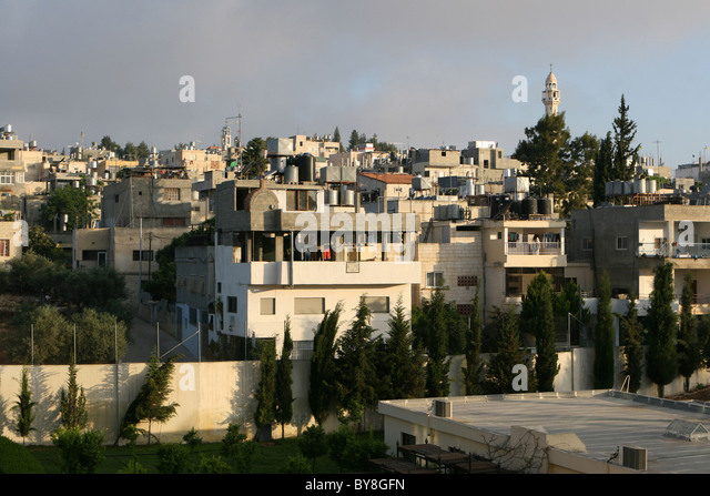 Multistory homes of Palestinians rise compactly across this hilltop in Bethlehem, Israel. A multitude of solar water - Stock Image