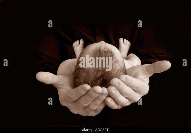 In the Father's hands - Stock Image
