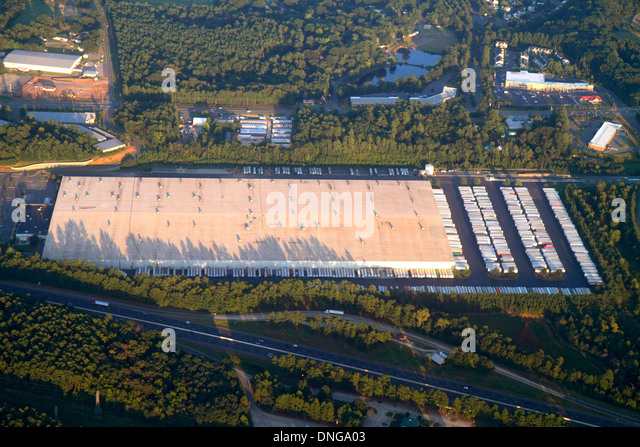 Charlotte North Carolina onboard inflight US Airways from Miami window seat view large warehouse aerial Ross Stores - Stock Image