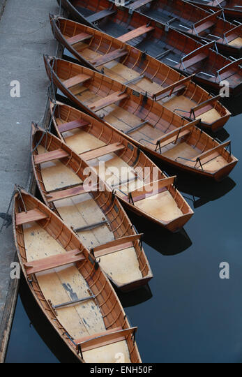 traditional wooden rowing boats on the River Wear in Durham - Stock Image