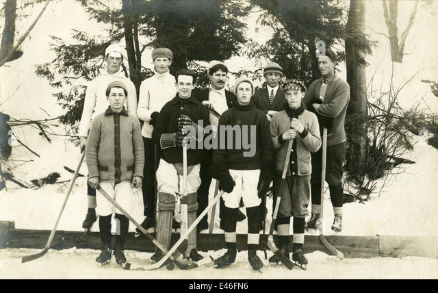 Antique photograph, circa 1910 image of a boys' pick-up ice hockey team, probably Quebec, Canada. - Stock Image