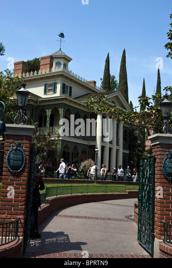 Gates open to the Haunted Mansion attraction at Disneyland Resort, Anaheim, California, United States of America. - Stock Image