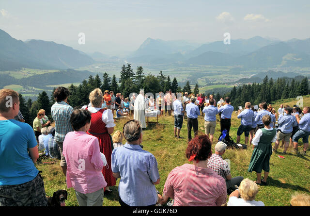 Moutain mass and church service over the Inn Valley, Bavaria, Germany - Stock Image