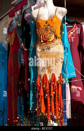 Egypt Kom Ombo tourist shop showing female manikin wearing skimpy tight dress - Stock Image