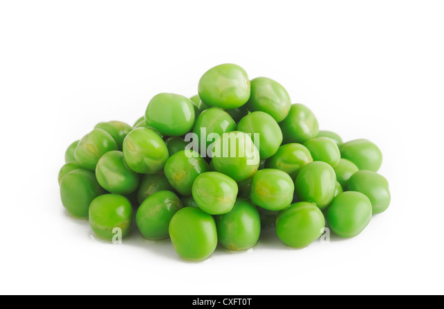 cooked green peas on white - Stock Image