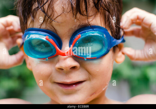 Portrait of boy (4-5) wearing swimming goggles - Stock Image