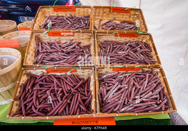 Buchettes ('sticks' of meats) for sale in street market - France. - Stock Image