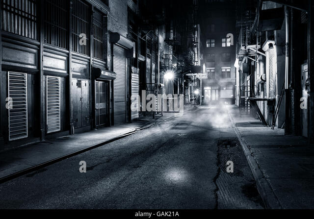 Moody monochrome view of Cortlandt Alley by night, in Chinatown, New York City - Stock Image