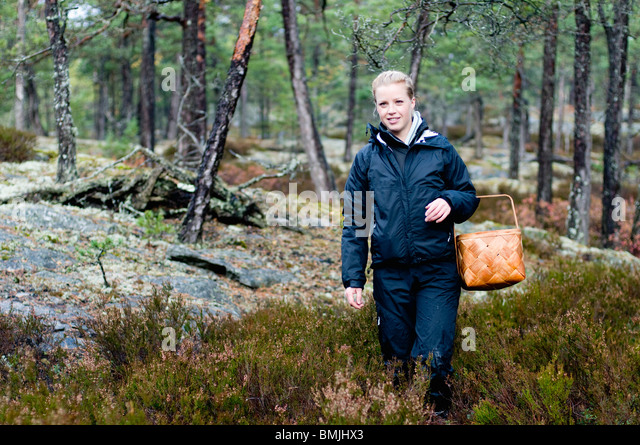 Woman with basket in the woods - Stock-Bilder