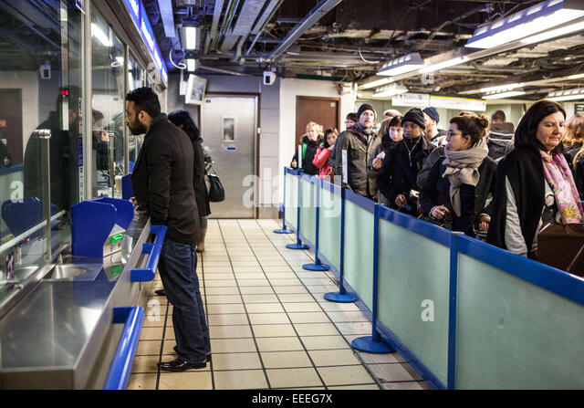 Getting assistance at a London Underground ticket office - Stock Image