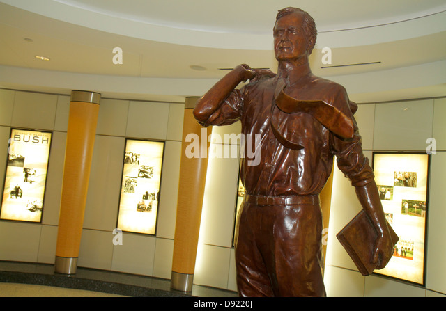 Texas Houston George Bush Intercontinental Airport IAH concourse gate area statue former president - Stock Image