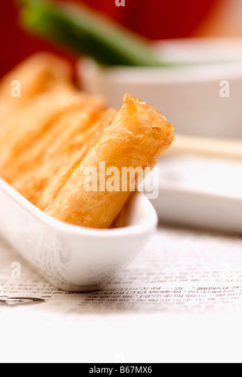 Spring rolls in a bowl - Stock Image
