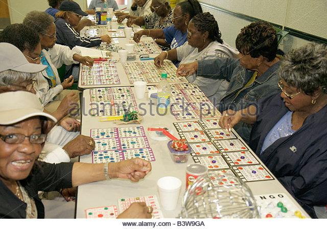 Miami Florida Charles Hadley Park community senior center activities Black woman women bingo game chance recreation - Stock Image