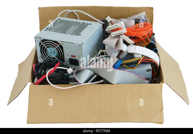 Cardboard box with the old used computer stuff  waste and garbage. Isolated with patch - Stock Image