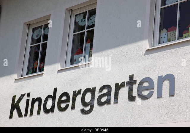 Kindergarten sign on facade of building, Germany, Europe. Photo by Willy Matheisl - Stock Image