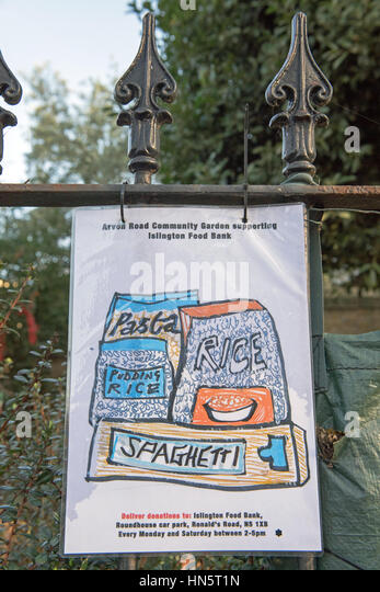 Islington Food Bank notice, hanging from railings in and supported by, Arvon Road Community Garden, Highbury, London - Stock Image