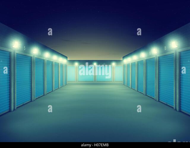 Outdoors storage units at night , Self storage facility - Stock Image