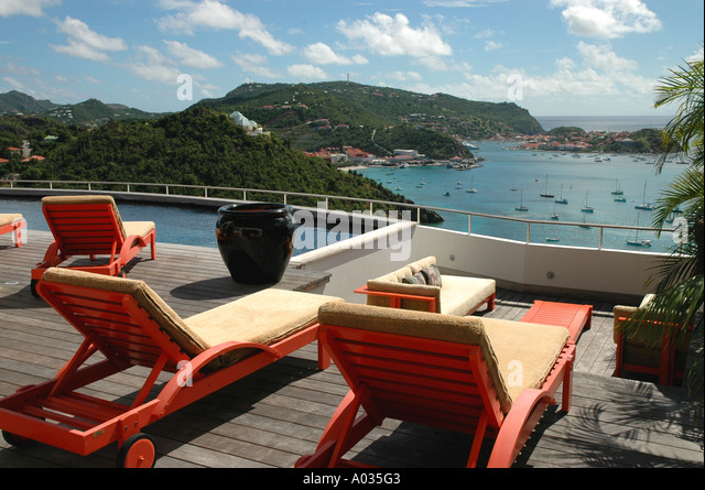 Saint Barth St Barts Private rental Villa Pool lounge chairs overlooks Gustavia Harbor Caribbean sea - Stock Image