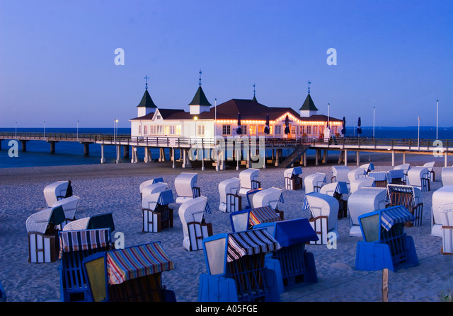Usedom Ahlbeck beach chairs art nouveau wooden pier twilight - Stock Image